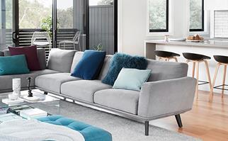 Scandi style living room with grey sofa and blue accent colours