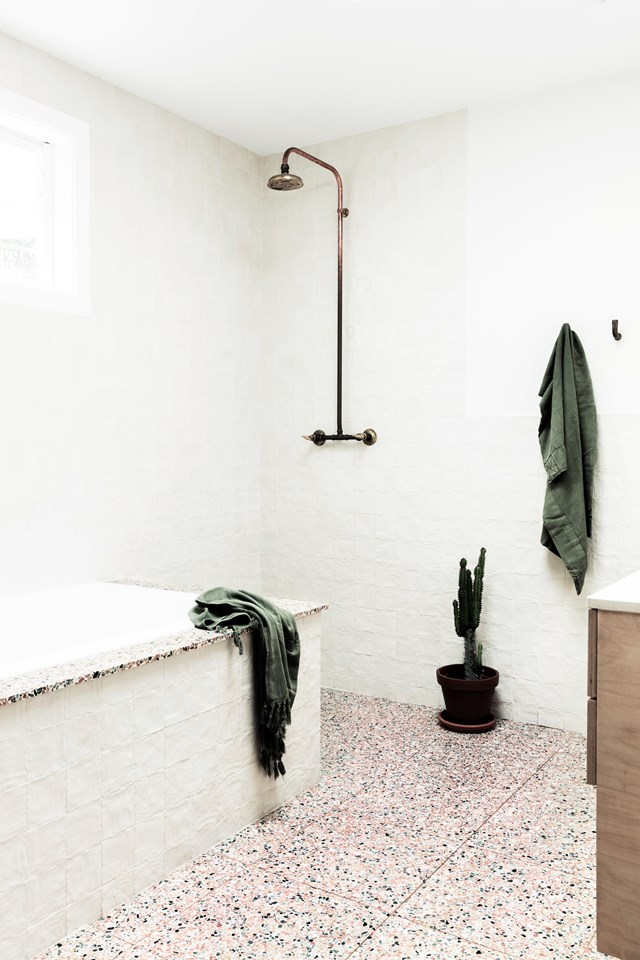 "This bathroom in a [1970s bungalow in Byron Bay](https://www.homestolove.com.au/a-1970s-byron-bay-bungalow-updated-with-hygge-style-6983|target=""_blank"") was given a complete overhaul. The end result is a space with a calming palette and pops of statement terrazzo. *Photo: Maree Homer / Styling: Kerrie-Ann Jones / Story: Real Living*"