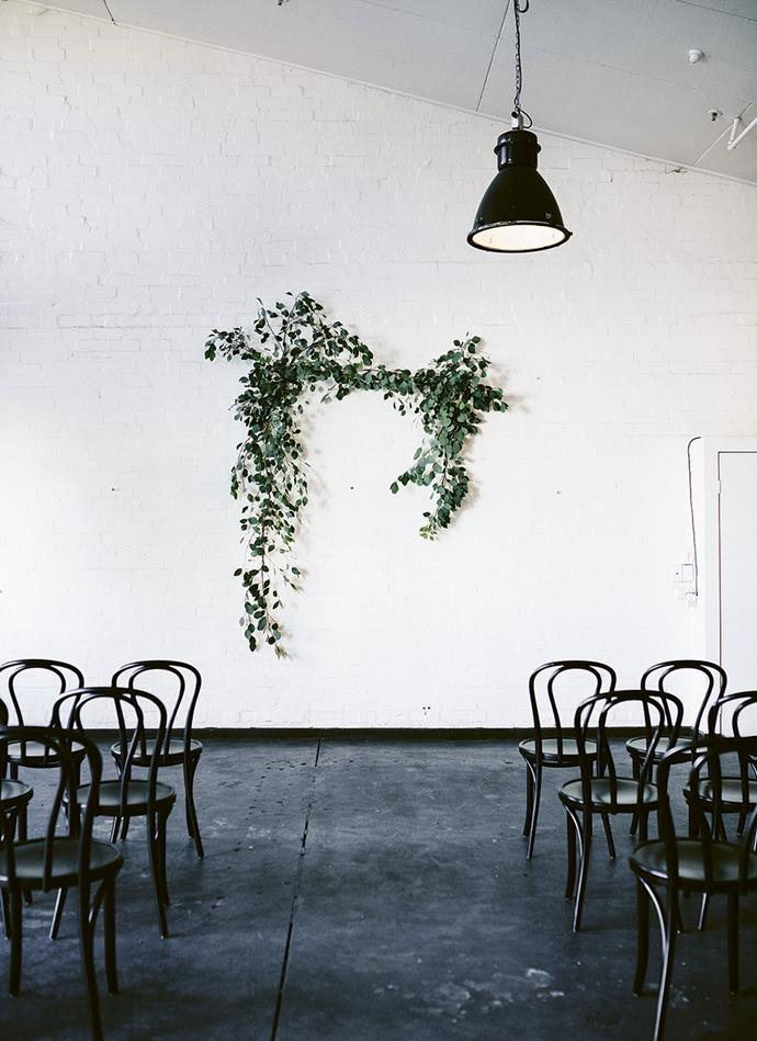 The minimal but striking foliage installation at the ceremony. *Photography: Marnie Hawson* | *Styling: Pot & Pan*