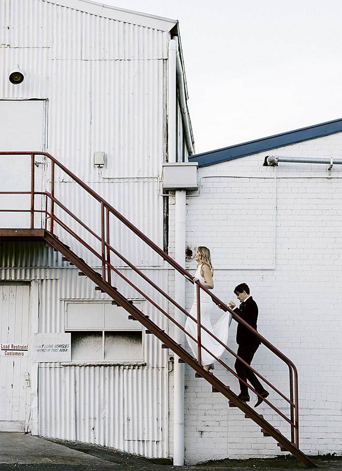 Jenah and Simon take the stairs up to the industrial Gather & Tailor Warehouse, which provided a blank canvas to be styled to any theme. *Photography: Marnie Hawson*