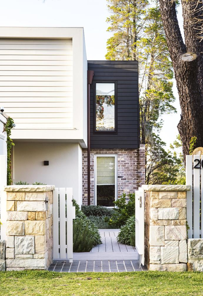 **Entrance** Sandstone pillars and a front gate painted in Dulux Grey Pebble Quarter welcome visitors. Scyon 'Linea' cladding is painted in Dulux Black Caviar, while recycled bricks from The Brick Pit add texture.