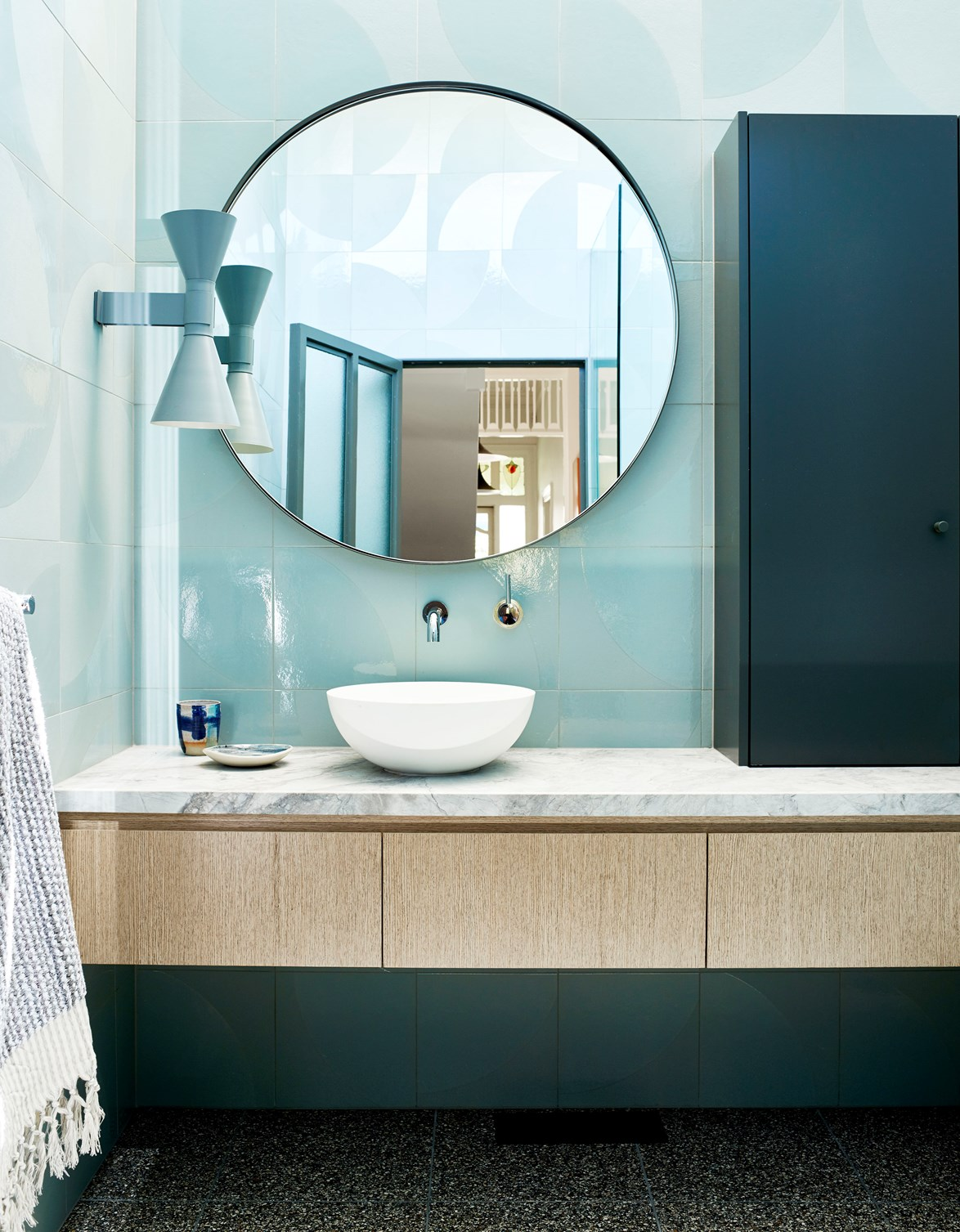 Ceramic tiles in blue-green tones have a calming effect in bathroom designed by Mardi Doherty and Michelle Evans. *Photo:* Mark Roper