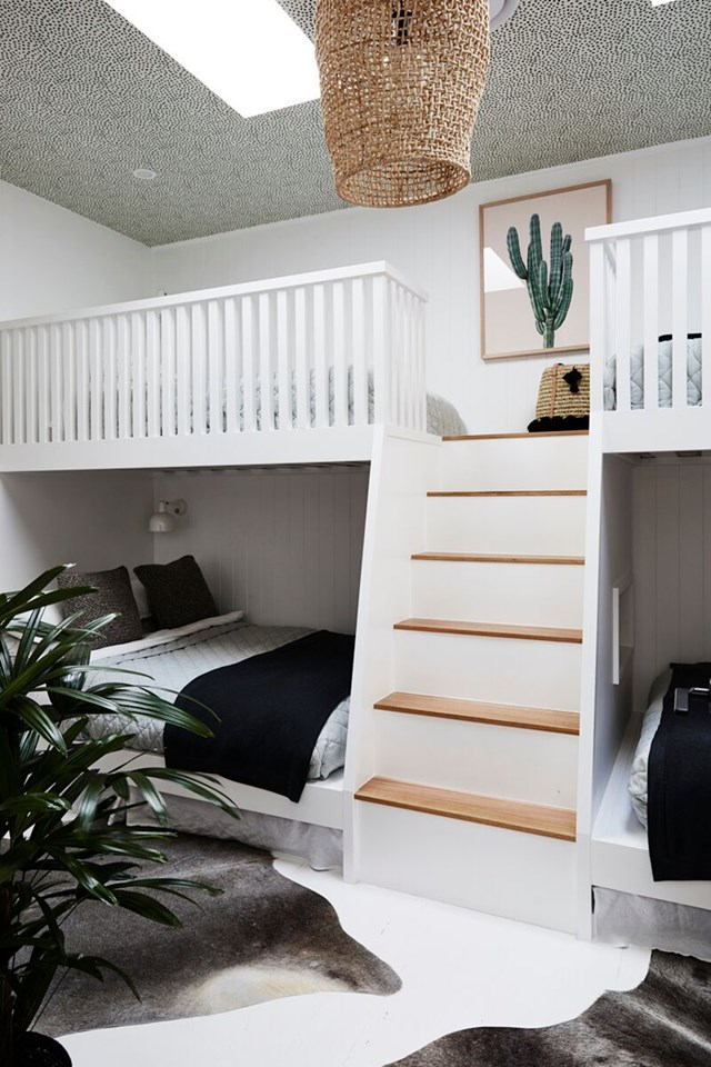 """Ceiling wallpaper lends a feeling of fun, as well as texture, to this monochromatic bunk bed room. When renovating the [Byron Bay cottage](https://www.homestolove.com.au/byron-bay-reno-before-and-after-6908
