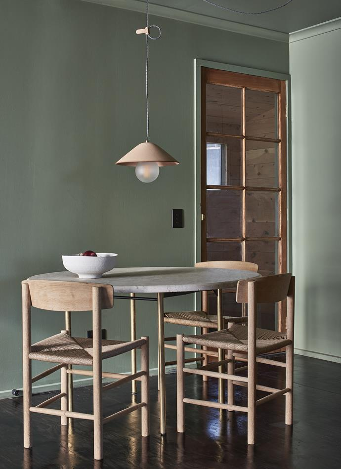 """Andrea found the travertine stone tabletop online and had the brass and steel base custom-made. The restored Borge Mogensen J39 chairs are from [Grandfather's Axe](https://grandfathersaxe.com.au/ target=""""_blank"""" rel=""""nofollow"""") in Melbourne. The doors and windows are crafted from reclaimed cedar and have been left natural. The leather pendant light was made by [IE Francis](https://iefrancis.com/ target=""""_blank"""" rel=""""nofollow""""). *Photography: Lachlan Moore*"""