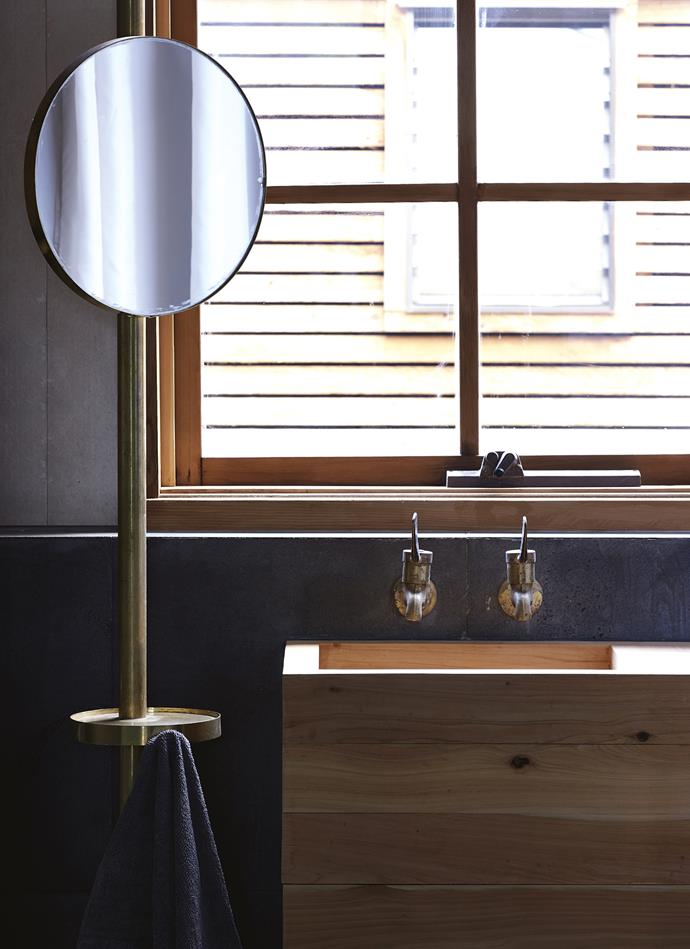 The bathroom sink was made from cypress. Lindsay custom-made the mirror, which doubles as a light, shelf and towel hook. *Photography: Lachlan Moore*