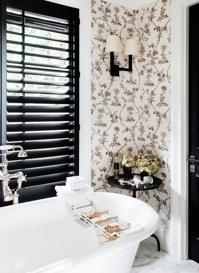 Black shutters made the traditional style bathroom feel modern and fresh.