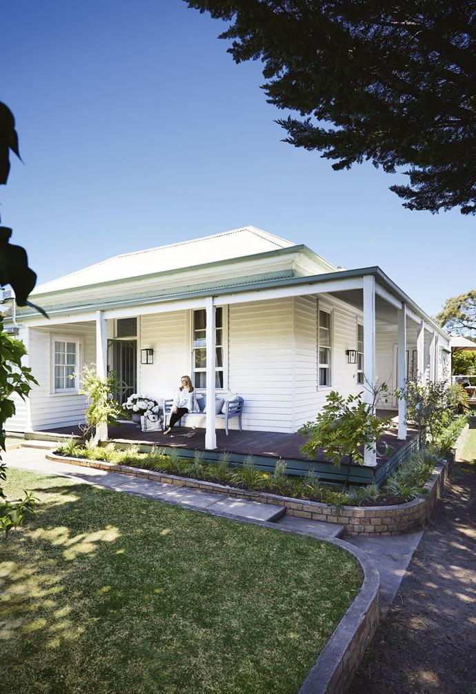 **Exterior** Homeowner and interior designer Dea sits on the wraparound verandah of 'Franklin'. Beautifully restored from the original cottage, this home had been untouched since 1940. *Styling: Julia Green | Photography: Armelle Habib.*