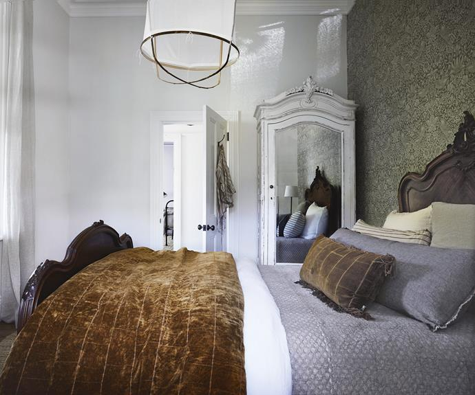 "**Guest bedroom** This solid timber bed from Because Antiques and a white armoire make this a cosy, welcoming room, enhanced by the feature wallpaper from The Dempsey Group. The Ay Illuminate pendant light from Côte Salt adds a beachy feel. Bedlinen, [Sheridan](https://www.sheridan.com.au/|target=""_blank""