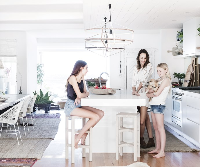 "**Kitchen** Kylie, Jasmine, Holly and Diego gather around the expansive Caesarstone benchtop. Kylie removed the covers from the LivedIn Coogee pendant lights to expose the frames. 'Terzini' bar stools in natural, [MCM House](https://www.mcmhouse.com/|target=""_blank""
