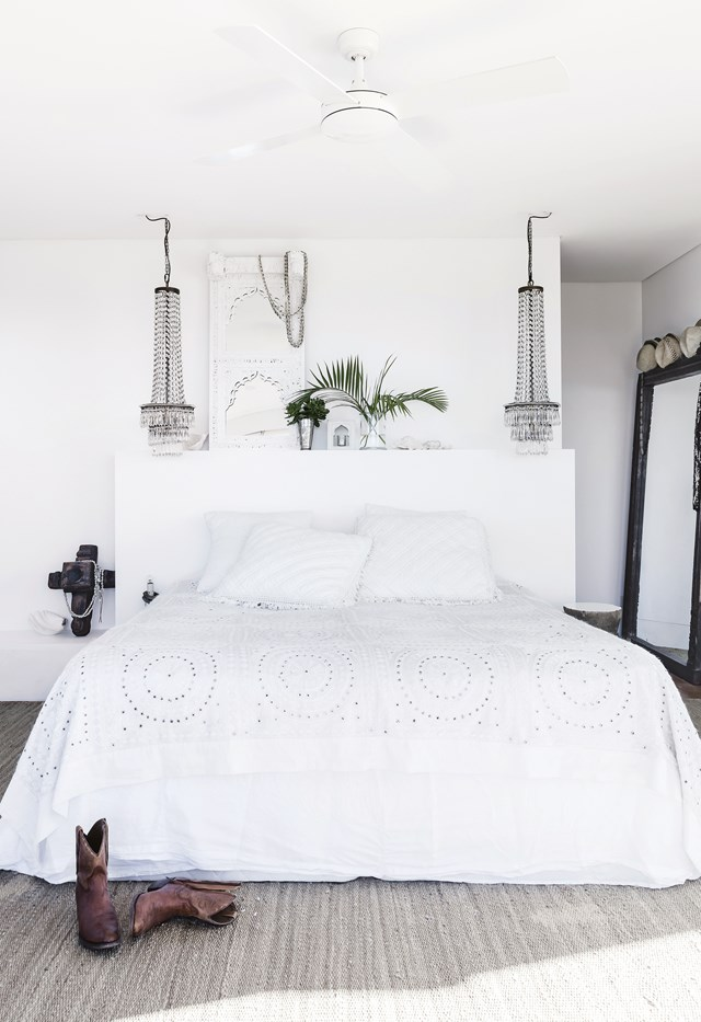 "Chandelier pendants add a luxe touch to the master bedroom in this [oastal home that nails white-on-white design](https://www.homestolove.com.au/beach-boho-this-coastal-home-nails-white-on-white-design-7048|target=""_blank""). Photo: Maree Homer / *Inside Out*"