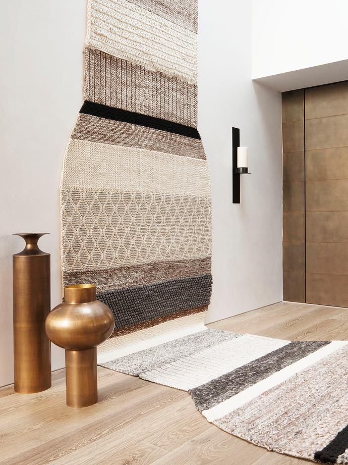 Melbourne home by Rob Mills Architecture & Interiors. Photograph by Shannon McGrath. Styling by Imogene Roache. From *Belle* April 2016. Handcrafted tapestry wall hanging-cum-rug by Patricia Urquiola.