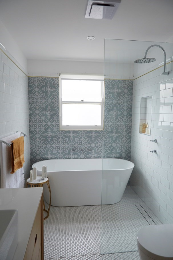Statement tiles and touches of timber add warmth to the main bathroom.