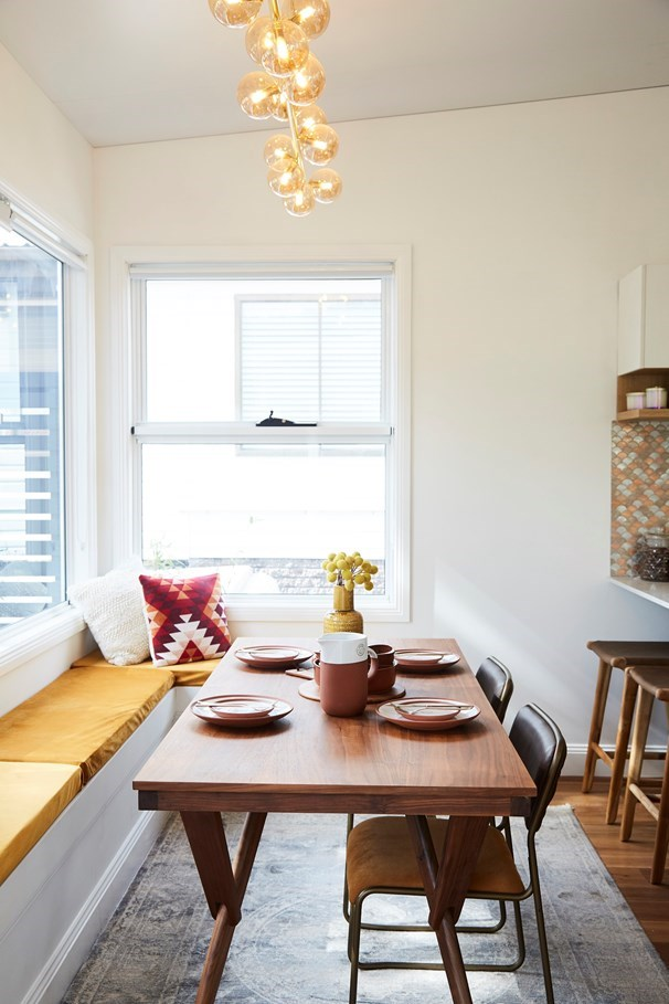Retro mid-century vibes prevail in the dining room.