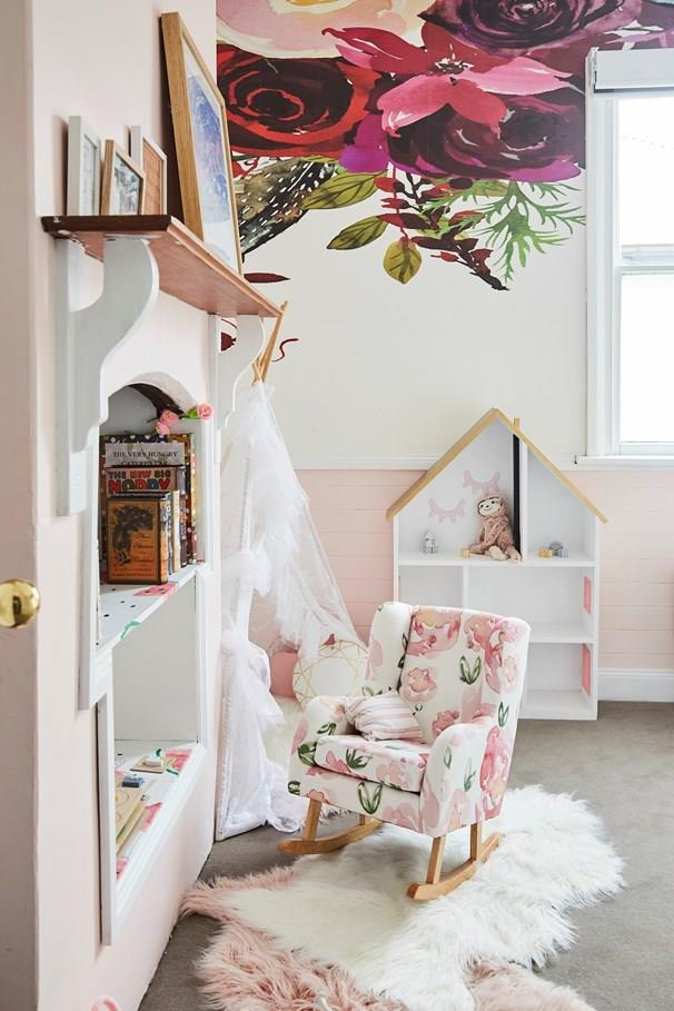 Bold floral wallpaper and a dusty pink palette creates a dreamy effect in this beautiful bedroom.