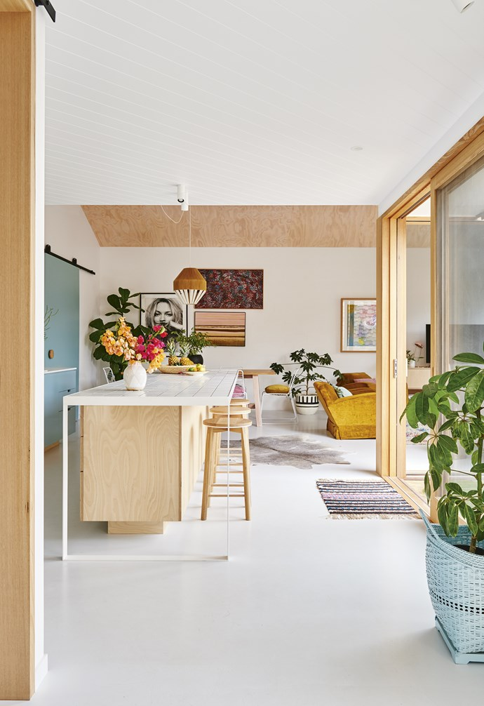 """**Kitchen** Pastel and desert tones are grounded by white walls and floors. Artwork: [Lola Donoghue](http://loladonoghue.com/