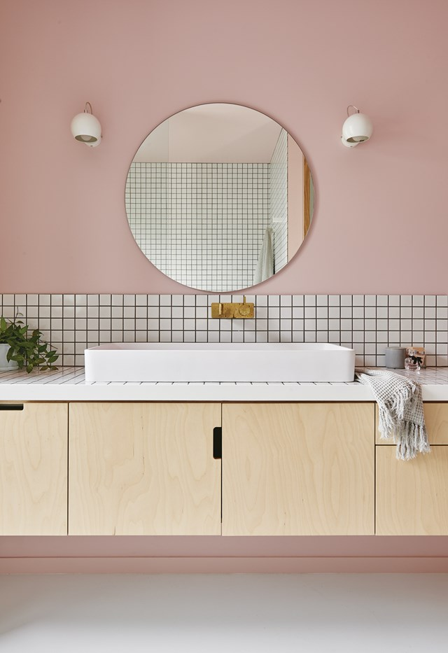 """Walls painted in Haymes *Shell Pink* paired with brass Sussex Taps tapware from Reece create a luxe palette in this powdery pink ensuite, while plywood cabinetry ties the space in with the rest of [stylish and creative home](https://www.homestolove.com.au/explore-an-interior-stylists-colourful-home-with-bold-ideas-7064 target=""""_blank""""). *Photo:* Nikole Ramsay   *Styling:* Emma O'Meara"""