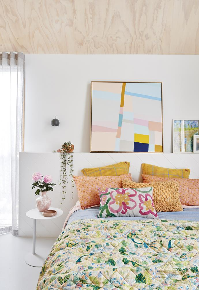 "**Master bedroom** A panelled shelf acts as a bedhead and offers plenty of space for displaying favourite items, including a large Tracey Mock artwork. Fresh white walls and a slim [GlobeWest](https://www.globewest.com.au/|target=""_blank""