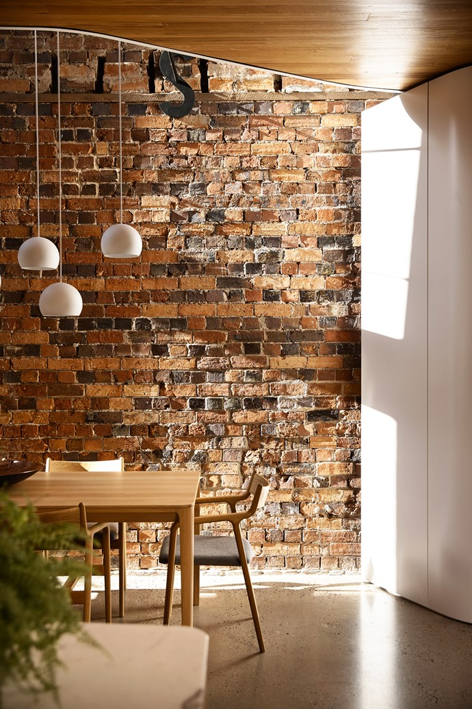 Toss B 'Sphere' pendant lights by Alain Monnens from Hub above Conde House 'Challenge' table by Peter Maly and 'Kamuy' dining chairs, all from Apato.