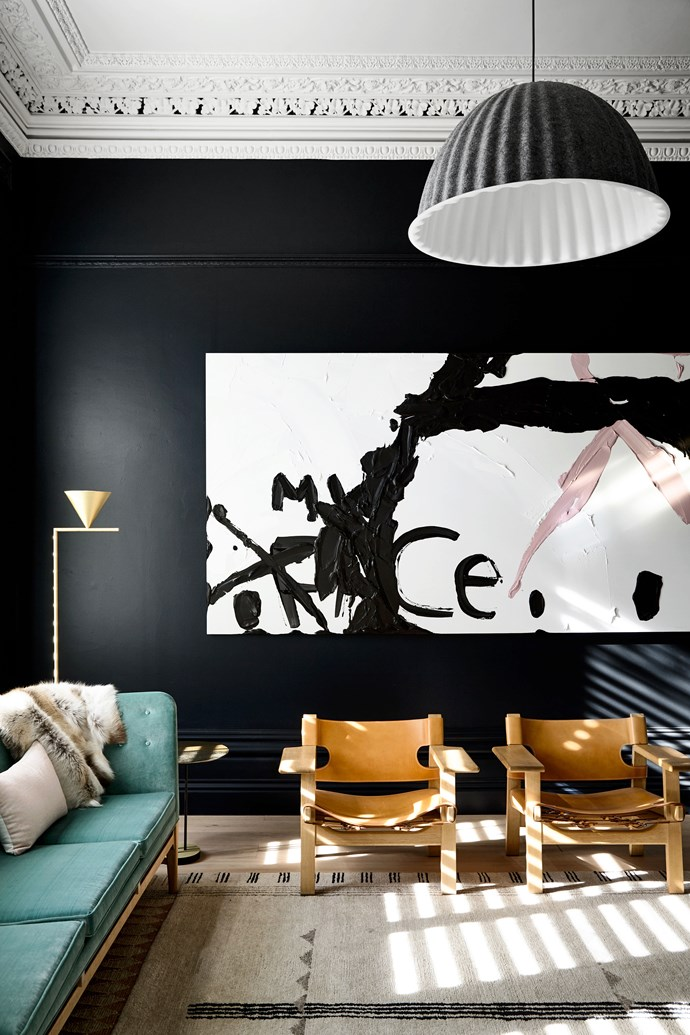 Room painted in Dulux 'Trespass'. Muuto 'Under the Bell' pendant light from Living Edge. Artwork by Kerry Armstrong.