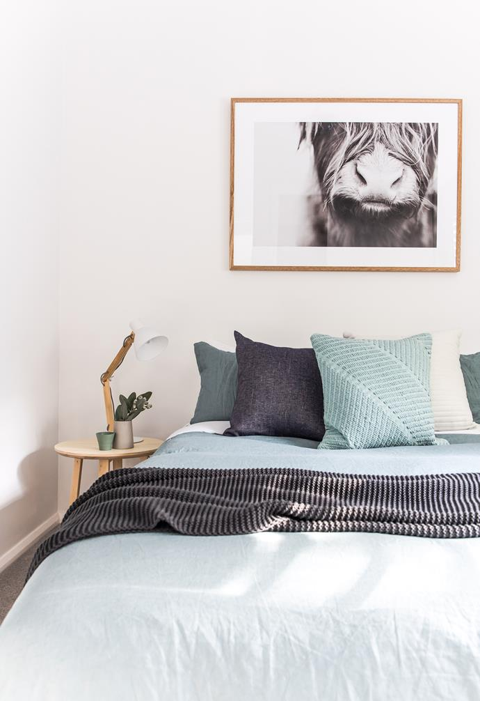 **Bedroom** Beautiful artwork decorates the apartment and adds to the pared-back yet luxe aesthetic.