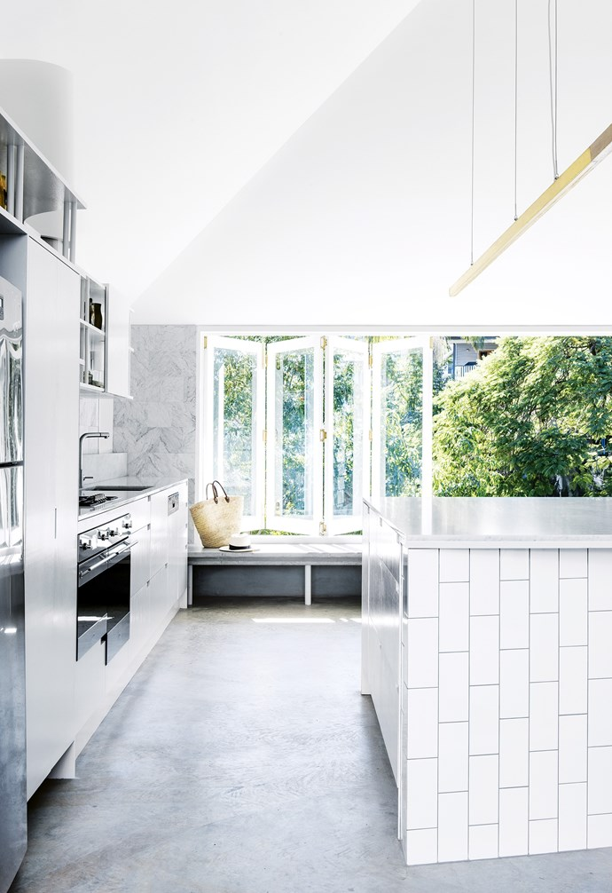 "**Design tip: think of your kitchen as a social space** ""Instead of treating your kitchen design as a wishlist of materials, think about it through the lens of how you'll live in it,"" says architect Paul Owen. ""In this kitchen, you can sit on the bench seat or at the island to engage with the cook."" Custom windows, [Allkind Joinery & Glass](https://www.allkind.com.au/