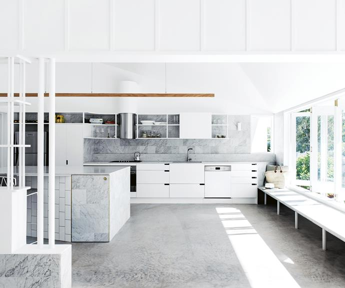 "**Design tip: built-in furniture works in small spaces** ""Built-in elements allow you to occupy the edge of spaces,"" says Paul. ""The bench seat in the kitchen can be seating or a servery, part of the dining setting or a place to dangle legs outside. Providing edges like this allows people to make their own space informally, and this makes for a pretty relaxed environment."" *Styling: Megan Morton 