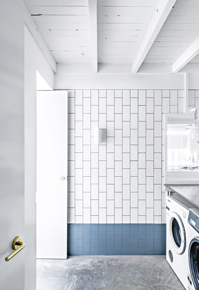 **Pop of colour** The blue subway tiles in the laundry echo the design of the bathroom. *Styling: Megan Morton | Photography: Cathy Schusler.*