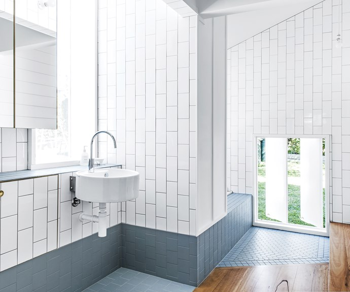 "**Design tip: use colour to unify** ""We used the blue tiles to blur the boundaries between the wall, floor and bath hob, which also reduces the number of different elements in the bathroom,"" says Paul. Tapware, [Astra Walker](http://www.astrawalker.com.au/