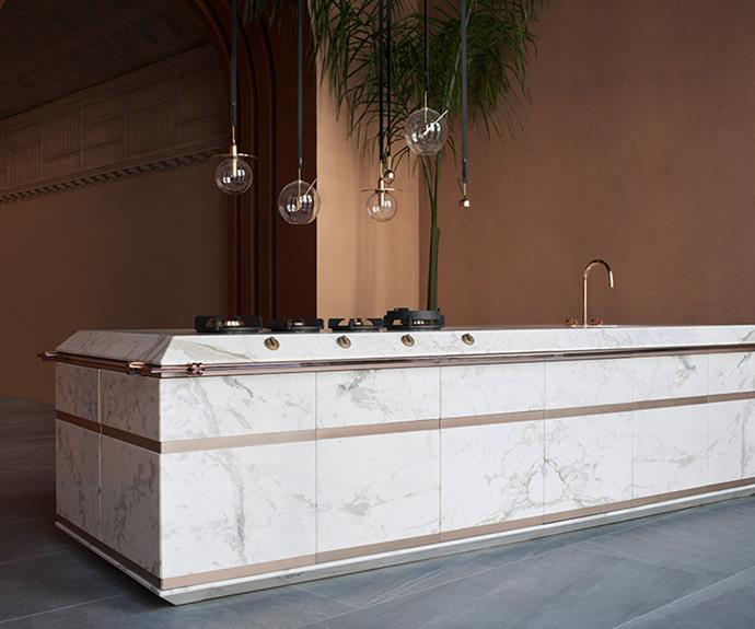 "**Ginger** ""The combination of Calacatta Gold marble and Copper Bronze metal creates a feeling of well being and relaxed atmosphere where everything lives together in a perfect equilibrium,"" say the Fendi Cucine team. *Photography: courtesy of Fendi Cucine*."