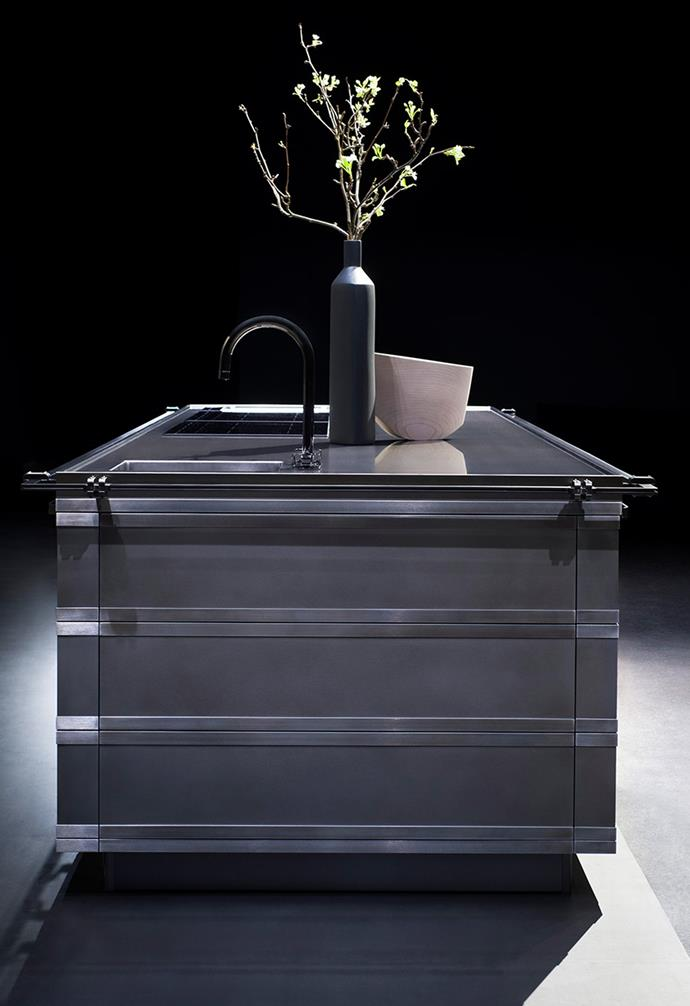"**Kurkum** As Ginger's moodier sibling, Kurkum sports a predominantly black and grey palette that ""is revealed by the combination of various materials that give a technical but sophisticated image to the project."" *Photography: courtesy of Fendi Cucine*."