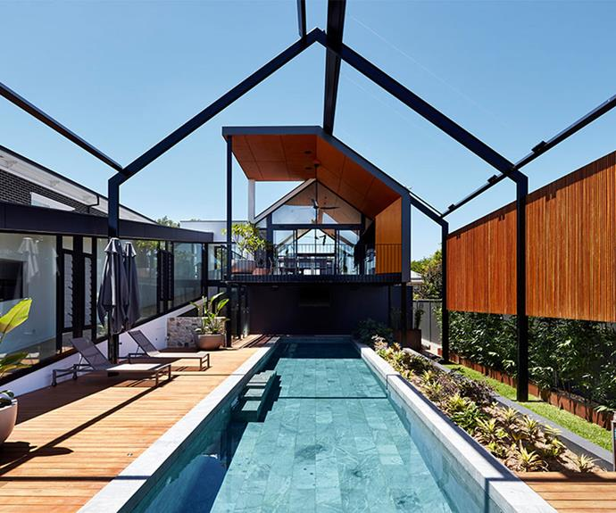 The living area and master bedroom overlook the heated swimming pool, encouraging the owners to go for a dip. Motorised, retractable sails provide shade during Adelaide's hot summer.