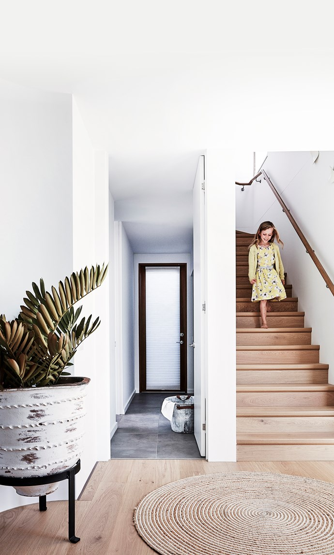 Thea makes her way down the Quick-Step stairs; the view here is through to the under-stairs laundry, with the garage door at left.