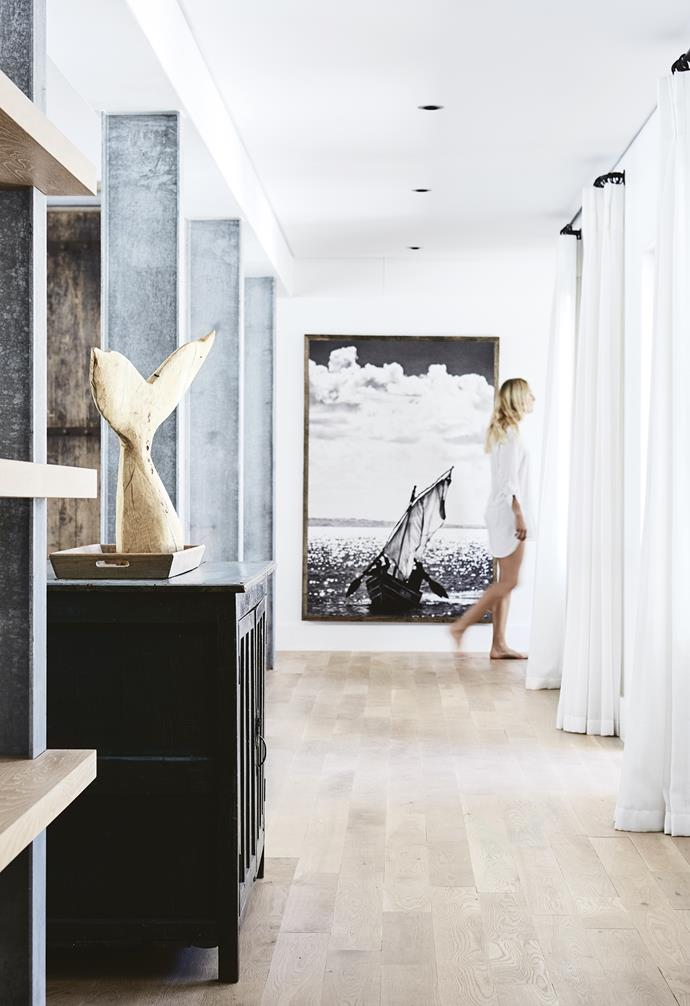 **Hallway** Canadian beech flooring was salvaged by the builder from a previous site.The artwork is from Amatuli, a shop in South Africa, and Nicola bought the carved whale tail on the side of the road in Grahamstown. *Styling: Sven Alberding | Photography: Warren Heath*.