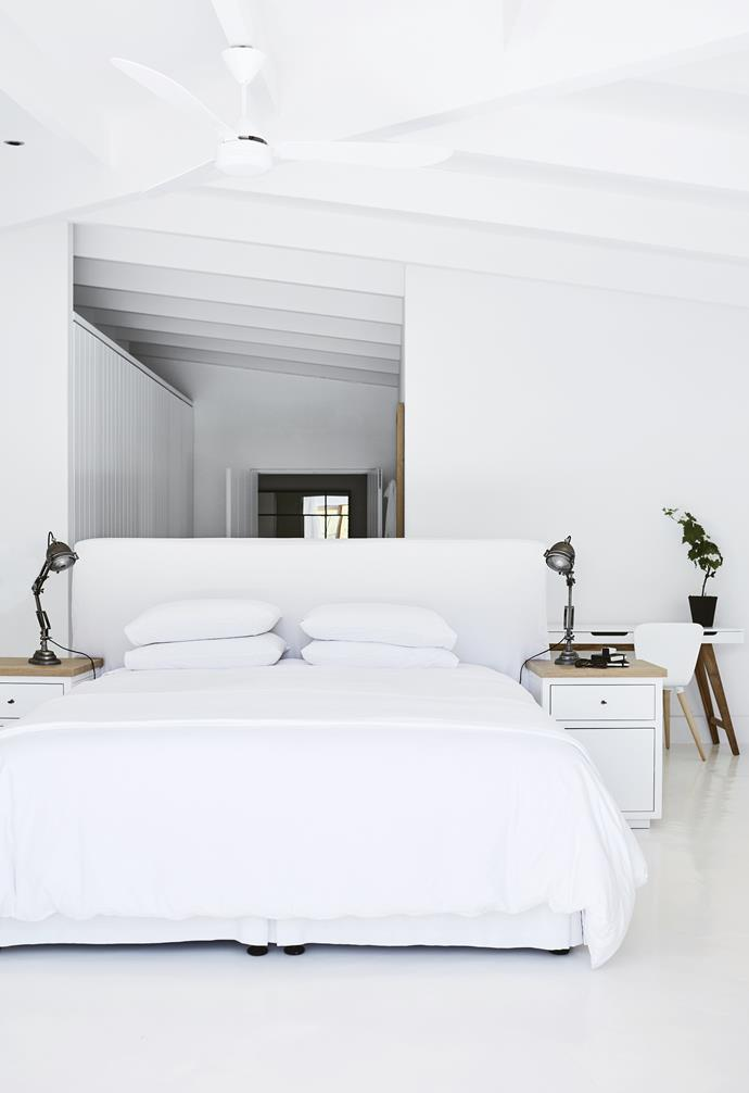 **Master bedroom** This space is a calming sanctuary that reflects Nicola's fuss-free, minimalist style. An oversized bedhead divides the space, ensuring a peaceful outlook from the sleeping zone. *Styling: Sven Alberding | Photography: Warren Heath*.