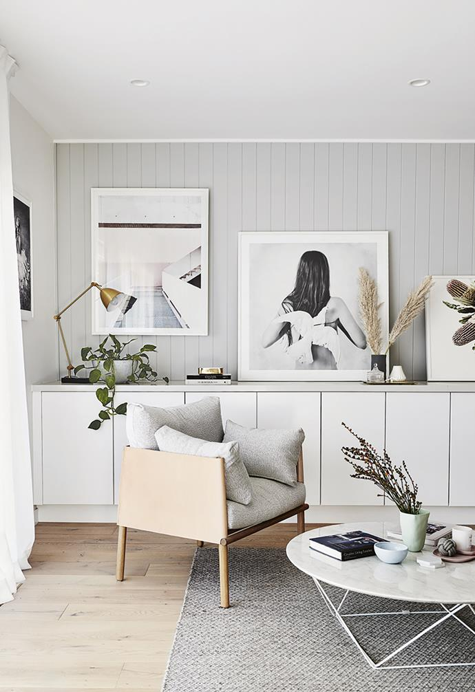 """**Living area** A row of built-in storage hides books, toys and homework clutter, while also acting as a surface for [displaying artworks](https://www.homestolove.com.au/how-to-create-an-art-gallery-wall-4860 target=""""_blank"""")."""