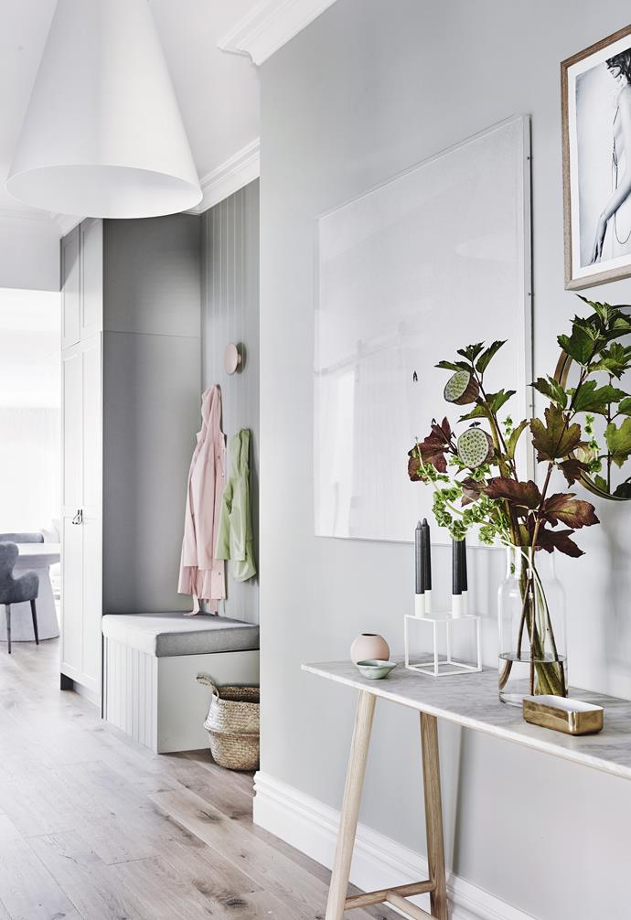 "**Hallway** School bags find an easy home in this tall hall cupboard. The narrow console is perfect in a busy family home. Artwork: *Love Warriors No 5 - Withering* by Ela Strand & Anna Scholtz, [Norsu Interiors](https://norsu.com.au/|target=""_blank""