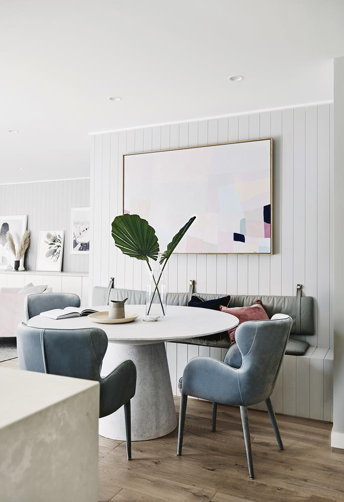 "**Dining area** The huge Tracey Mock artwork, a piece commissioned through Norsu, defines the dining zone, offering a sense of movement above a grey and blue palette. Sculptural greenery adds drama. Ceramics by [Batch Ceramics](https://batchceramics.com.au/|target=""_blank""