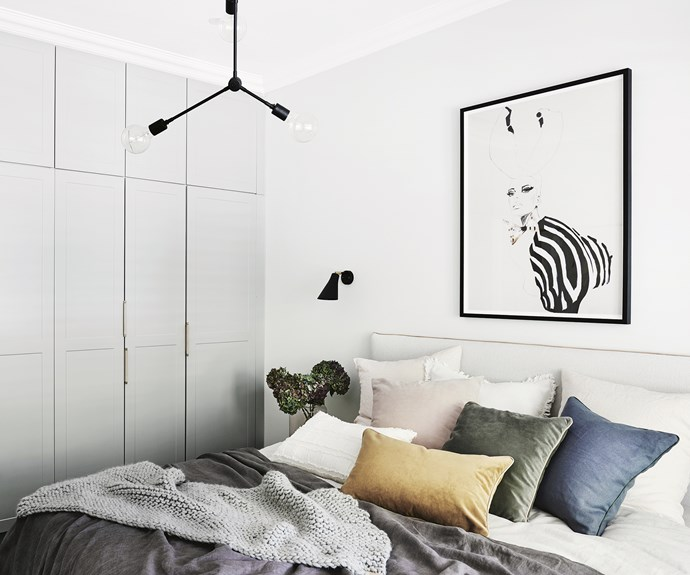 "**Hang tight** A combination of pantry cupboards and standard base cupboards were used for wardrobes in the master bedroom. ""We took out adjustable shelving and added hanging rails from [Bunnings](https://www.bunnings.com.au/