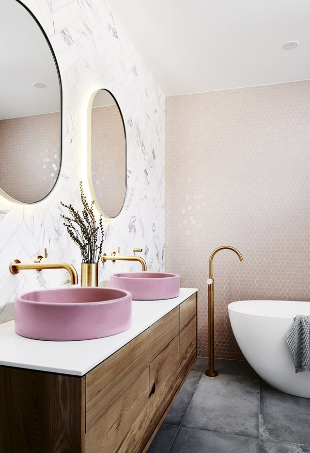 """A [Scandinavian style home](https://www.homestolove.com.au/scandi-style-family-home-7108 target=""""_blank"""") is not complete without a pop of pink! Twin pink basins from [Nood Co.](https://noodco.com.au/ target=""""_blank"""") are the standout feature in [Norsu Home](https://norsu.com.au/pages/norsu-home target=""""_blank"""" rel=""""nofollow"""") co-founder Nat Wheeler's blushing bathroom, where marble, pink mosaics, timber and brass combine to create a swoon-worthy space. *Photo:* Lisa Cohen   *Styling:* Nat Wheeler"""