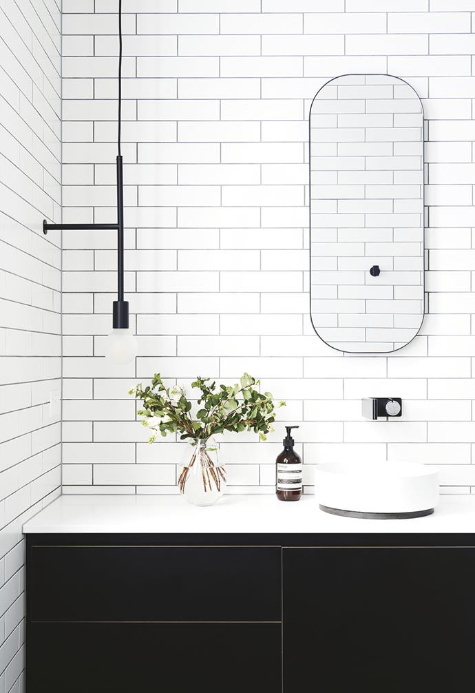 "**Ensuite** They selected Volker Haug lighting and more angular tapware in their ensuite. ""We were more adventurous in our choices there,"" says Philip. Alape Unisono Counter Basin No Taphole 325mm in White and Milli 'Axon' Wall Basin Mixer Set 185mm in Chrome/Matte Black, [Reece](https://www.reece.com.au/