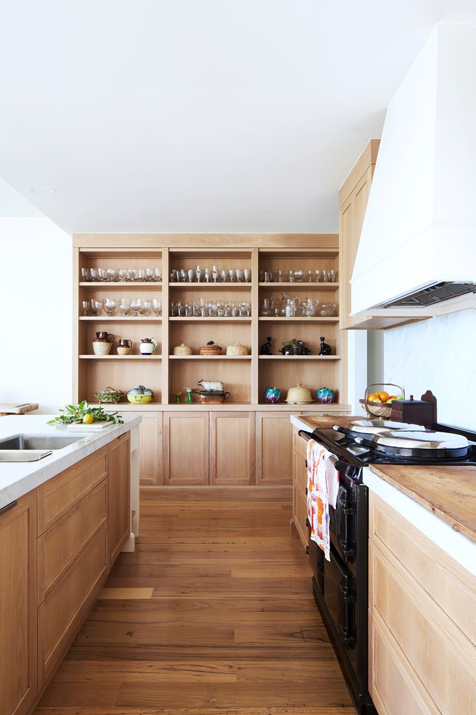 Fresh and timeless, the kitchen features new oak cabinetry.