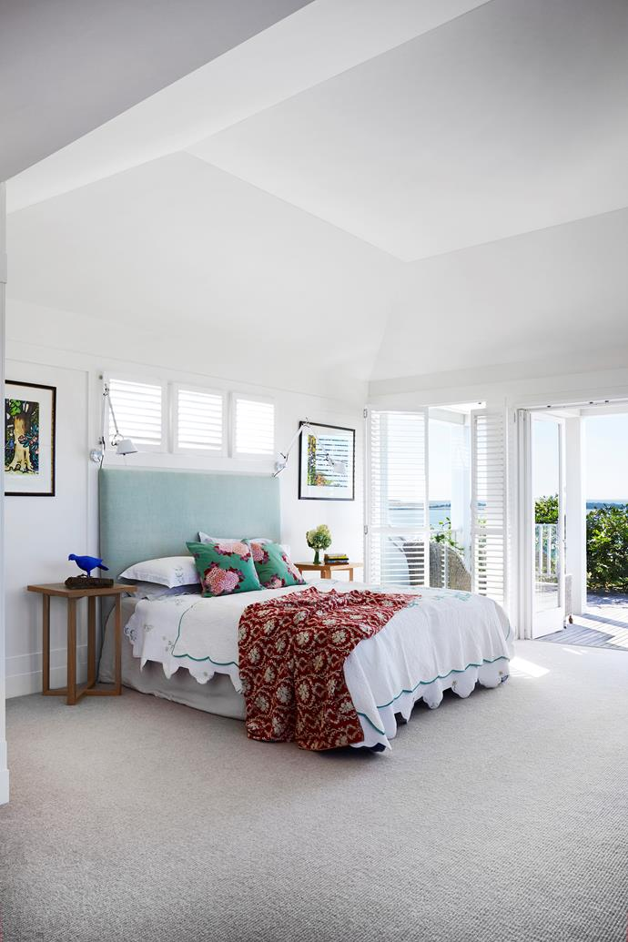 Nellie and Dougal enjoy magnificent views of Swan Bay from their first-floor bedroom and private balcony. Bed, Harvey Norman. Alpaca loop-pile carpet, Carpet House. Paintings by Guy Charon.
