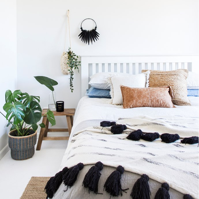 It's the finishing touches like cushions, throws and plants that give this bedroom warmth and style.