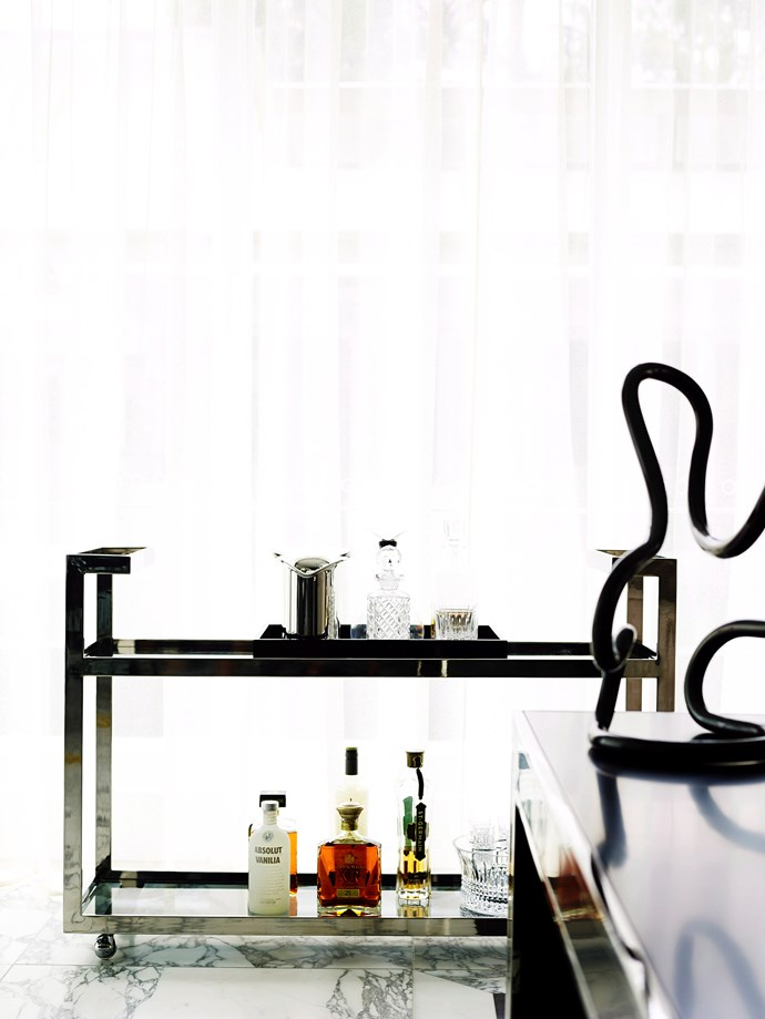 A well-stock and styled drinks trolley is a great way to invite guests to fix a drink for themselves. Photo: Anson Smart / *bauersyndication.com.au*