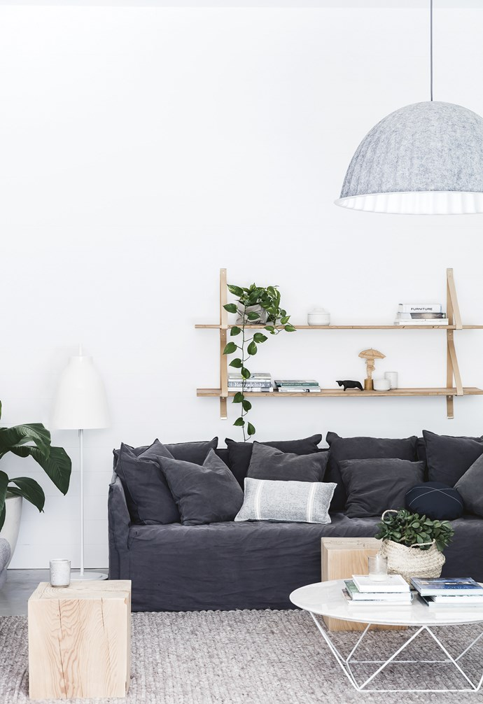 "**Living area** The large Muuto 'Under The Bell' pendant light adds texture and softness above a cosy MCM House sofa. The sleek GlobeWest coffee table is complemented by a pair of Mark Tuckey timber side tables. 'Assemblages' shelving, [Lightly](https://www.lightly.com.au/|target=""_blank""