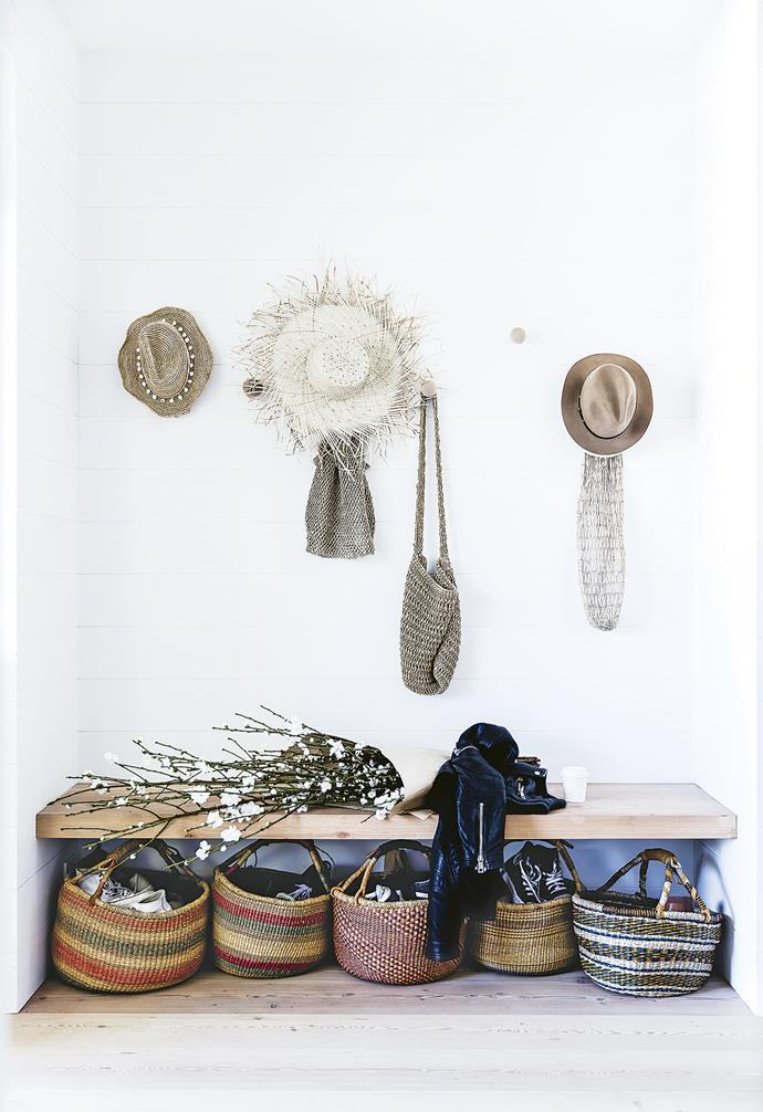 **Entry** Beach-ready hats and bags greet the family and guests at the door. The built-in bench is a handy spot for putting on shoes.