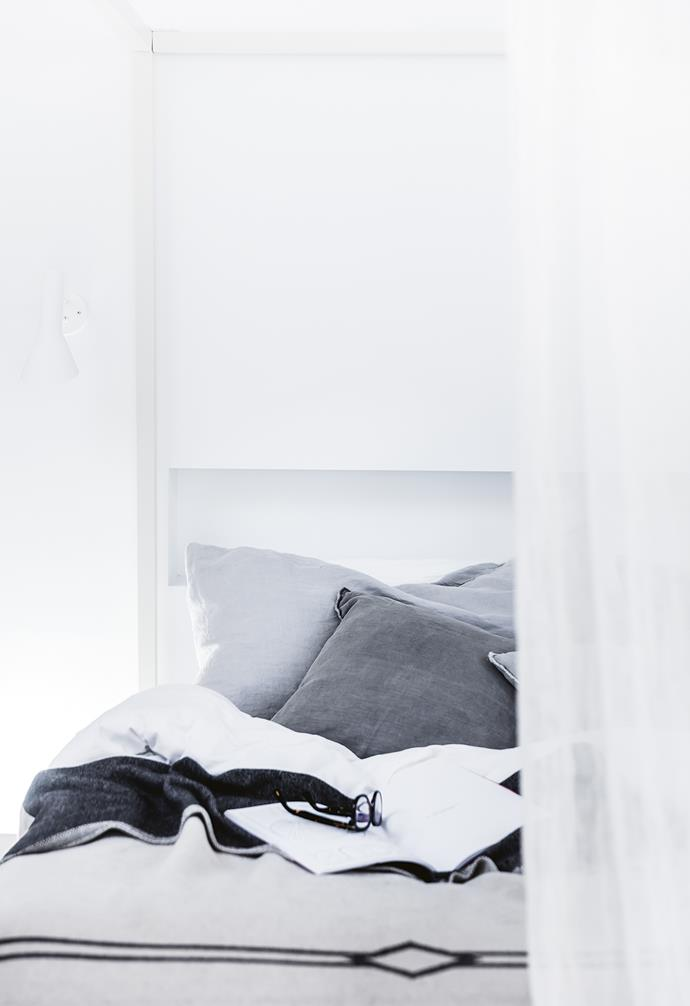 **Master bedroom** Soft grey and white creates a calming palette.
