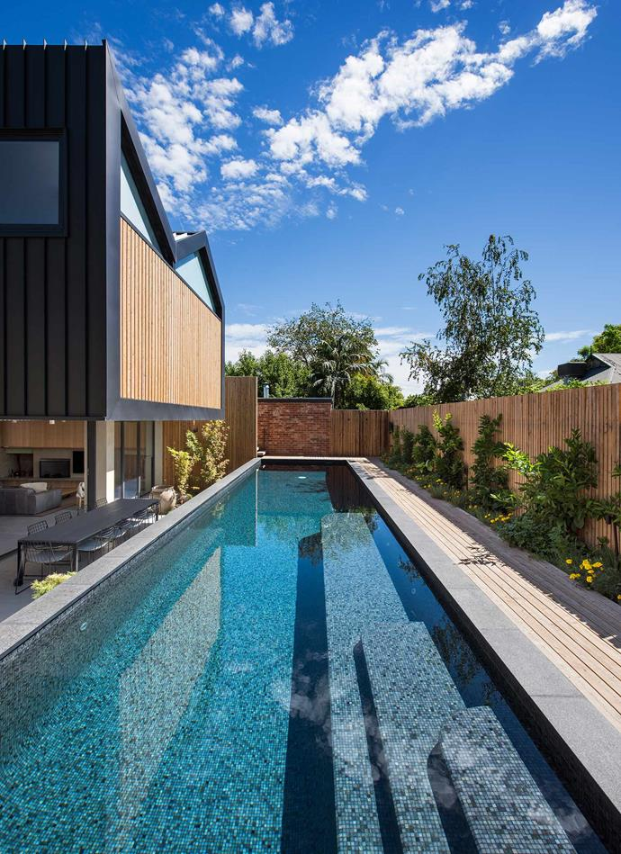 In the backyard, the lap pool is raised to sit 1.2 metres above ground, which removes the need for a pool fence and keeps the natural flow between internal courtyard and outdoor space. Since Adelaide temperatures hover in the 'teens for most of the year, all windows are double-glazed for thermal comfort. *| Photography: David Sievers*