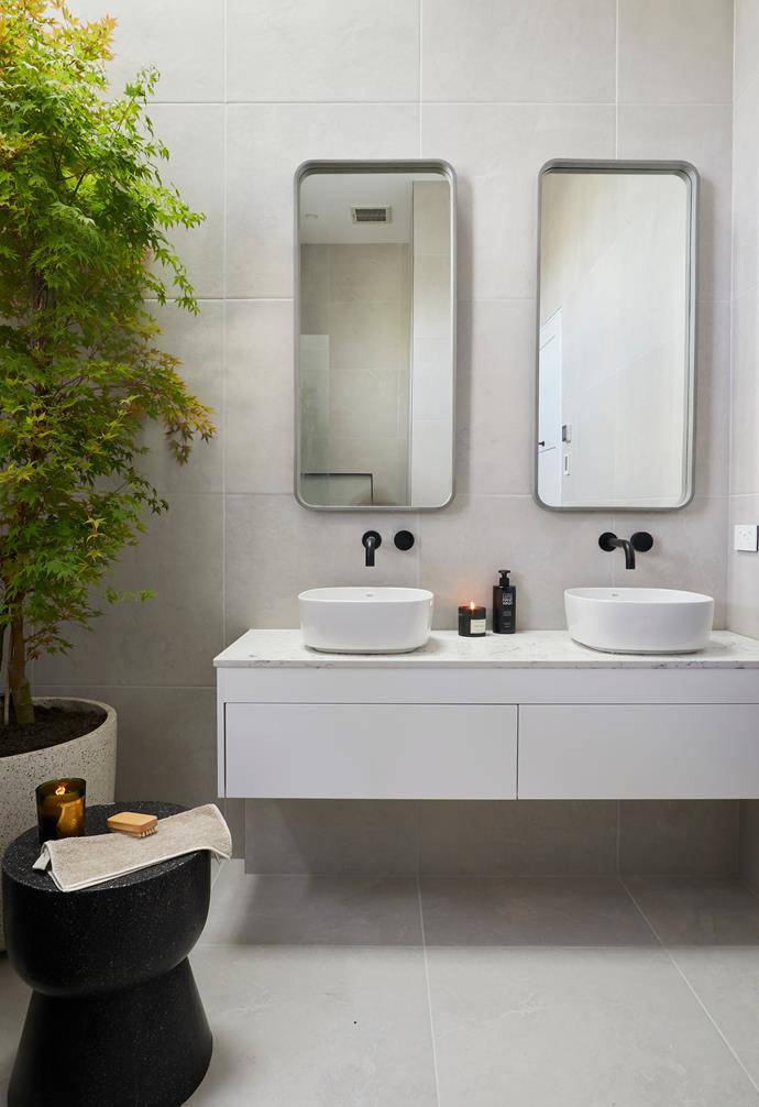 "**Norm and Jess** Twin concrete mirrors from [nood co](https://noodco.com.au/|target=""_blank"") add a striking touch."