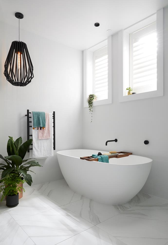 **Kerrie and Spence** This simple and clean bathroom makes the tiles its hero.